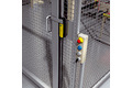 Safety locking devices and emergency stop pushbuttons on protective doors