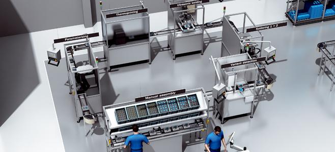 Delvis automatisk slutmonteringsanläggning med cirkulationssystem för arbetsstyckets bärare
