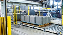 Production area at Eternit: Loading station for Eternit panels safeguarded by safety solutions from SICK