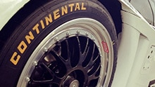 Detailed view: car tires with the Continental logo